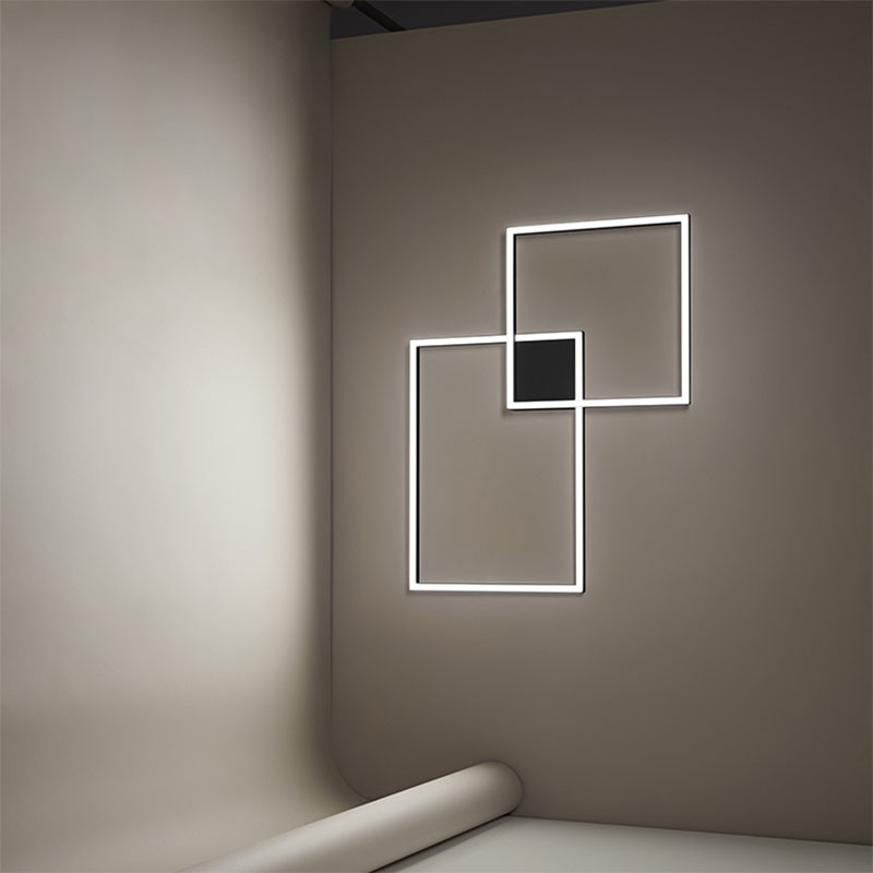 lampada a sospensione e a parete cross di perenz in alluminio nero
