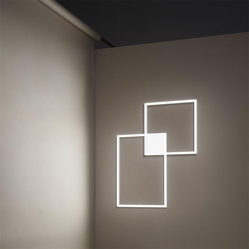 lampada a sospensione e a parete cross di perenz in alluminio bianco